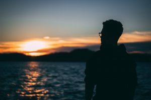 man at sunset contemplating divorce